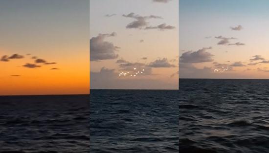 海面天空上有奇异的14个光点疑似ufo